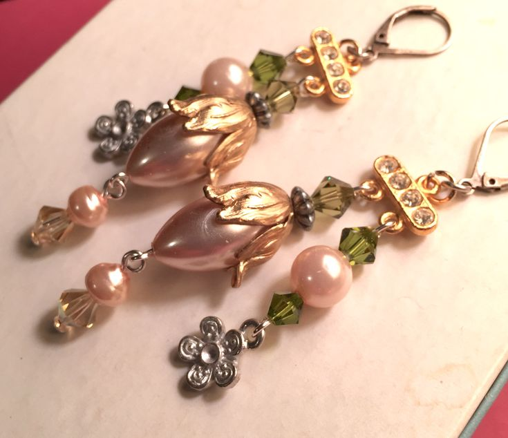 """November/December 2017 Challenge - """"Dreaming of Spring"""" Earrings by LoveBeadz Designs  Light peachy pearls, raw brass tulip bead cap and antique silver finish lever back ear wires from B'Sue Boutiques, as well as B'Sue by 1928 raw pewter flower drop. Swarovski crystal bicones in Olivine, Khaki and Light Peach AB."""