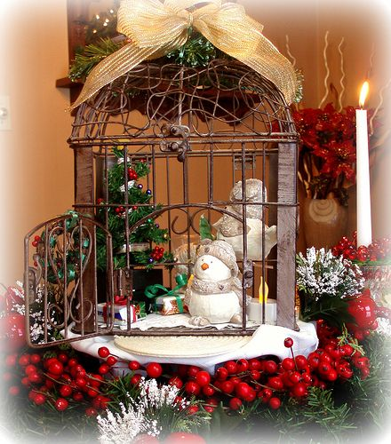 "Great holiday vignette with mirror in the background!!! Bebe'!!! Love the ""Frosty"" inside the wire cage!!!"