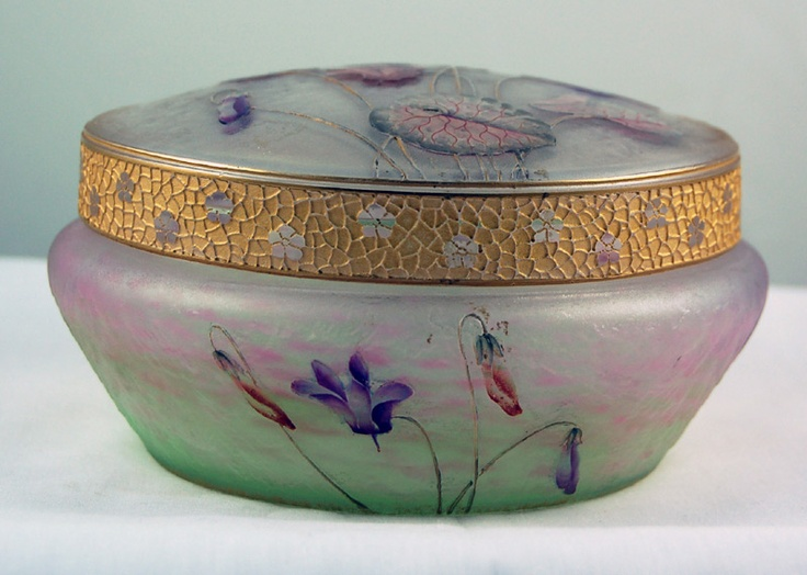 Daum Nancy Enameled and Gilt-Decorated Glass Box with Cover, circa 1910. 3 in. (7.5 cm) high 5 3/4 in (14.5 cm) diameter, signed in gilt Daum Nancy with Cross of Lorraine.Nancy Enamels, Art Nouveau, Trinket Boxes, Daum Nancy, Gilt Daum, Circa 1910, Glasses Boxes, Gilt Decor Glasses, Nouveau Deco