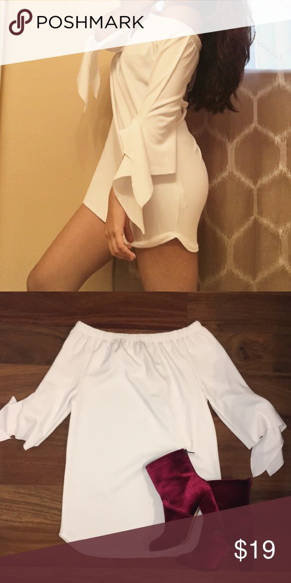 Off Shoulder shift dress Crisp white shift dress is everything! The off shoulder details gives you the option to dress it up or down! Best part of this shift dress is that it fits amazing, shows your curves elegantly. Perfect for day or night, any occasion! Dresses