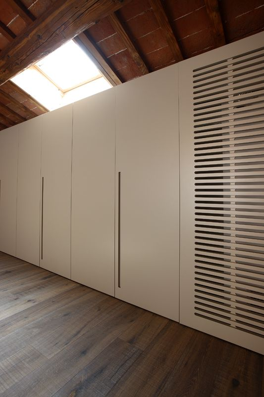 detail of the cupboards showing the custom ventilation grille that hides the dehumidifier