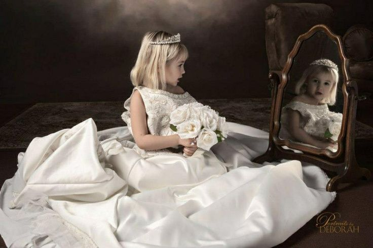 Daughter in mothers wedding dress