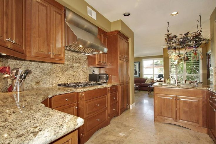 Traditional Kitchen With High Ceiling White Sand Granite Countertop Pendant Light Raised