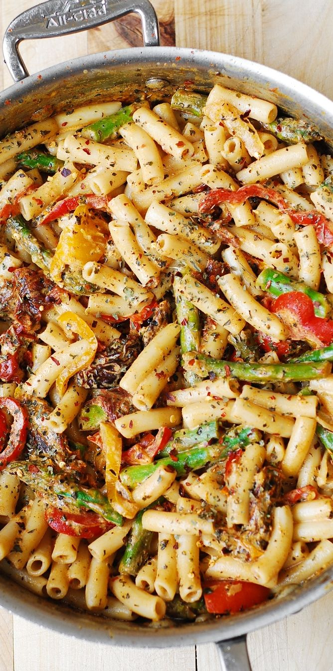 Penne Pasta, Bell Peppers, and Asparagus in a Creamy Sun-Dried Tomato Sauce, with basil and crushed red pepper. The vegetables taste so good with all the spices, pasta, and the flavorful creamy sauce in this Italian pasta dinner!