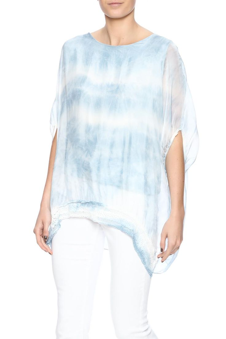 Sheer silk top with short sleeves, boat neckline, crochet trimming and asymmetric sides. Comes with a liner.   Blue Free Flowing Blouse by Ivy and Lace. Clothing - Tops - Blouses & Shirts Clothing - Tops - Short Sleeve Palm Beach, Florida