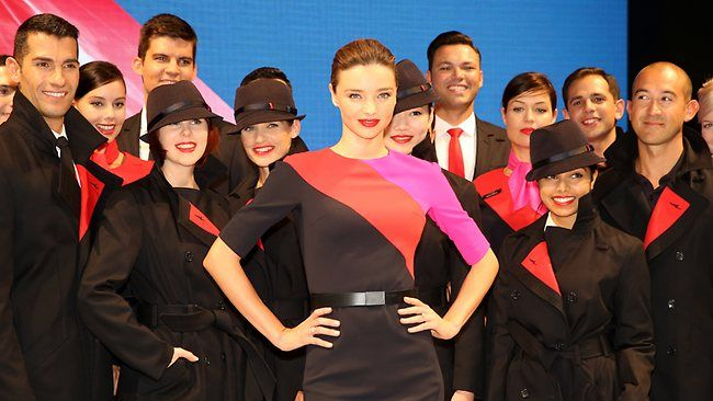 Qantas ambassador Miranda Kerr fronts staff wearing the new uniform at yesterday's launch. Martin Grant describes his design as `very film noir'. Picture: Nic Gibson Source: The Australian