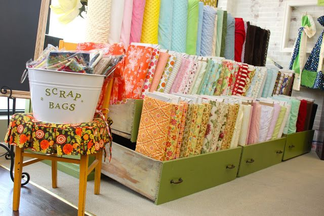 Smashed Peas and Carrots: Material Girl Fabric Shop and a Big Announcement! Fabric storage idea