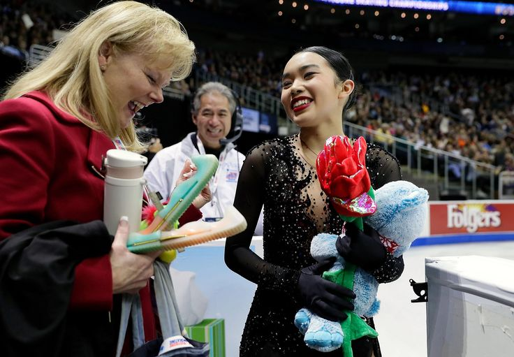 Karen Chen comes off the ice and is greeted by coach Tammy Gambill after her performance in the Championship Ladies Free Skate during the 2017 U.S. Figure Skating Championships at the Sprint Center on January 21, 2017 in Kansas City, Missouri.