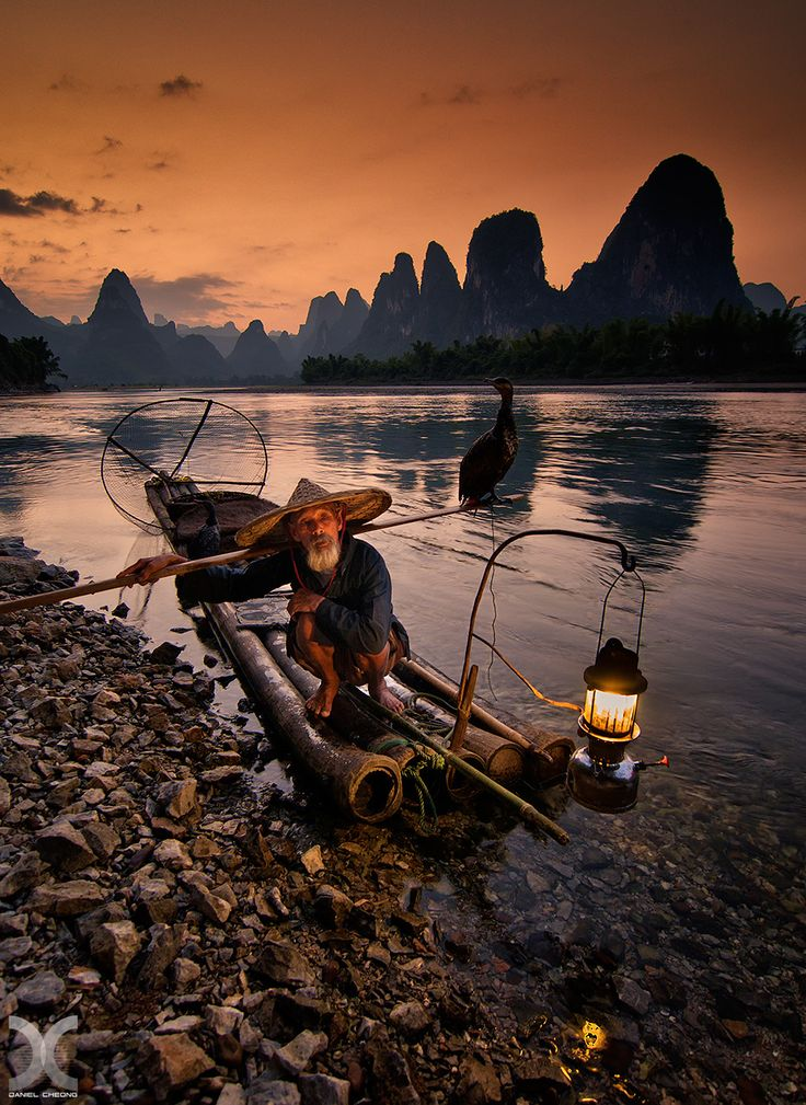Cormorant fishing on the Li River, China.  My website: www.danielcheongphotography.com Follow me on Facebook | Instagram