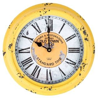 This gorgeous Antique Yellow Round Old Town Metal Wall Clock combines rustic charm with functionality. This gorgeous metal wall clock features a glass covering and a beautiful antique shade