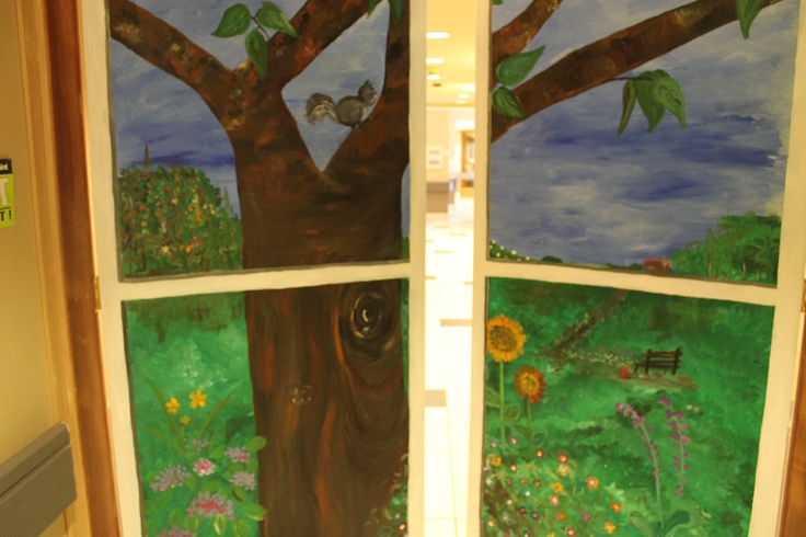 Mural on a door.  The idea is for it to look like a window looking out on to a peaceful scene.  It's in the secured area of a rest home where the patients with dementia and Alzheimer's are.