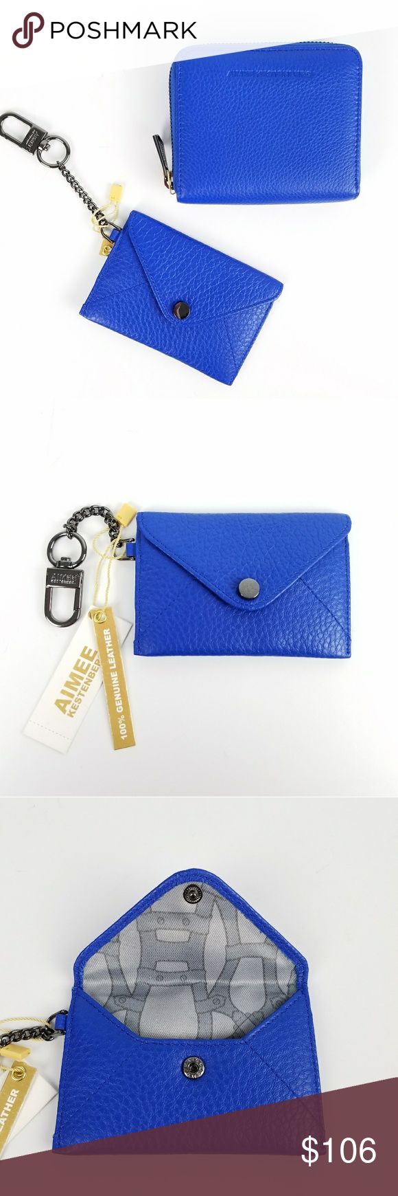 """Aimee Kestenberg Brixton Ashley Wallets  Combo New With Tags  Listing is for BOTH the Ashley Pouch and Brixton Wallet in Lapis Blue with gunmetal accents  Ashley Pouch:  100% genuine leather The perfect size for credit cards & ID  Snap closure Dogclip to attach to your bag Embossed back logo 3""""H x 4.5""""W x .5""""D  Brixton Wallet: 100% Genuine leather  Zip Around closure Triple interior compartment Double credit card slots Embossed back logo  4.75""""H x 4""""W x 1""""D Aimee Kestenberg Bags Wallets"""