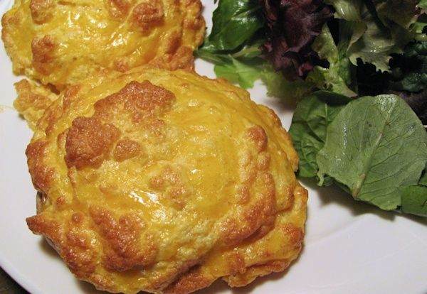 This delightful souffle style take on the traditional Welsh Rarebit is adapted from the Two Fat Ladies.