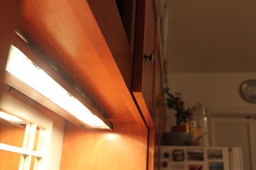Did you know that a seamless finish like this was possible with refacing? Working around the existing undercabinet light, the refaced cabinets look just as perfect as the new maple doors. These homeowners chose the recessed panel Madison style for their cabinet doors.  by Kitchen Saver.