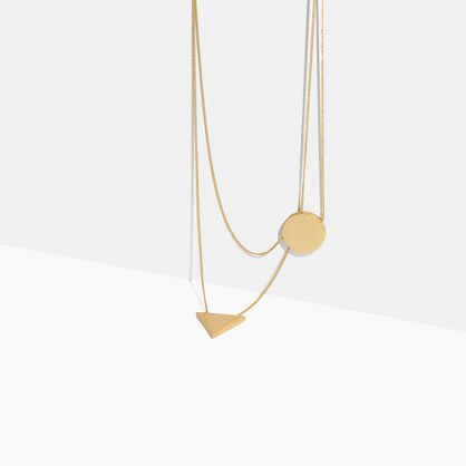 A fresh take on a simple pendant necklace: The double chain intersects the…