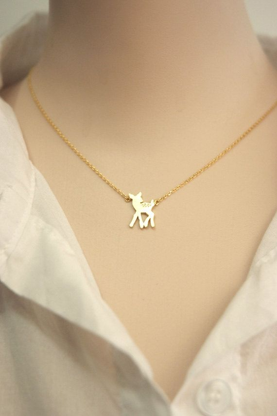 This isTiny bambi deer necklace in gold.  Its simple&cute.    LENGTH: 16 / (41cm)  PENDANT SIZE: 1.0*1.5cm Gold Plating over Brass finding and