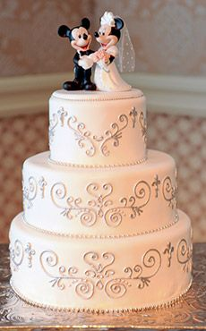 Inspiration Gallery - Wedding Cakes | Disney's Fairy Tale Weddings & Honeymoons I like this, nice and simple, with the sitting bride and groom I think