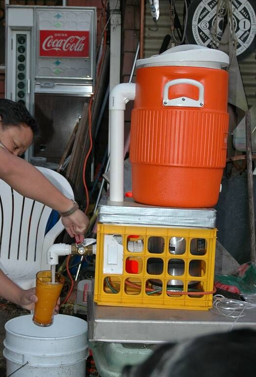 The Redneck Margarita Machine - uses a 5 gallon cooler, a new stainless steel garbage disposal, and some other parts to make an industrial blender/margarita maker.