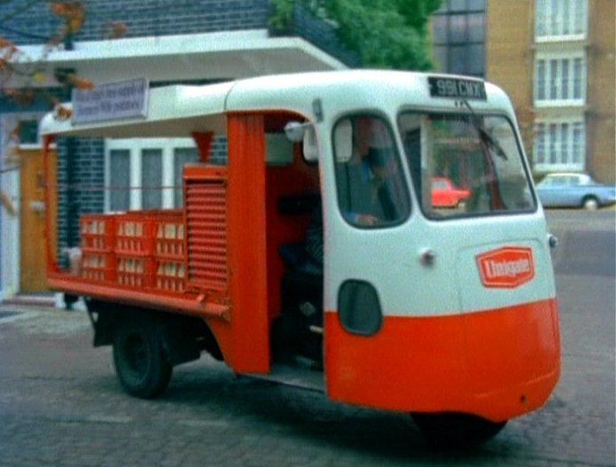 "Milk Float, Electric & driven by batteries, very ""Green"" for the time."