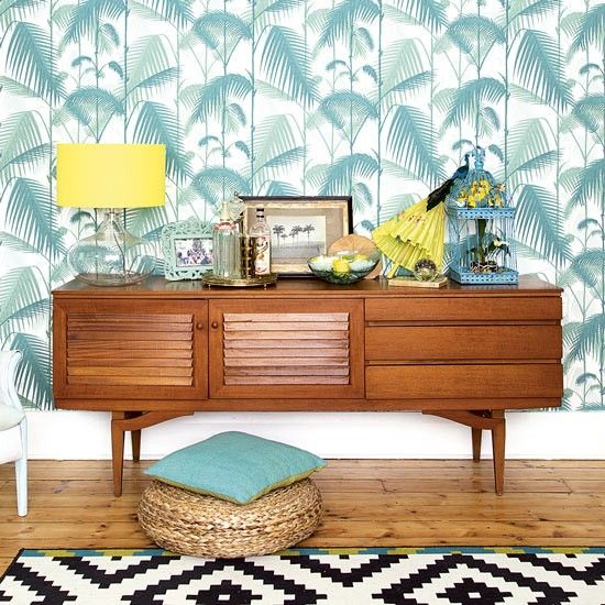 Retro hallway with tropical wallpaper and teak sideboard