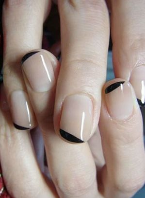 This two-toned manicure is subtle, but oh-so classy! A nude base coat w/ just a small line of black at the tip of the nail, this manicure is definitely on trend.