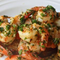Garlic Shrimp Ingredients for 2 large or 4 small portions: 1½tbsp olive oil 1pound shrimp salt to taste 6cloves garlic, minced fine ¼tsp red pepper flakes 2tbsp cold butter, cut in 4 pieces 3tbsp lemon juice 1tbsp caper brine ⅓cup chopped Italian parsley, divided water as needed to thin sauce