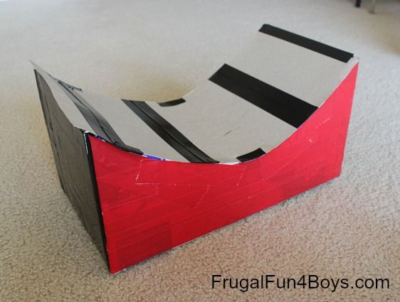 Turn a cardboard box into a jump for Hot Wheels cars! This is awesome...