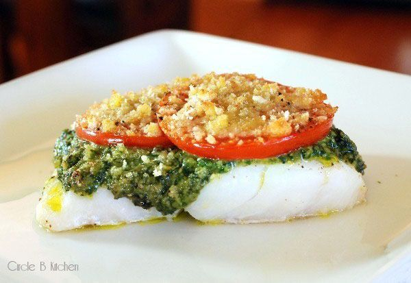 Roasted cod with basil pesto.    Just made and ate this and it rocks!  Super simple and easy to do.  We used our own pesto, small tasty tomatoes in slices, panko breadcrumbs, and then added a bit of grated parmesan on top.      I will definitely do this dish again!  Done in 15 minutes total!