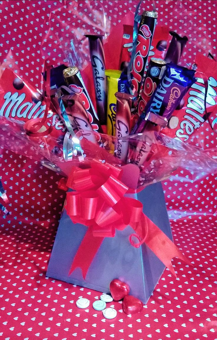 Chocolate Bouquet, perfect Valentines gift, great alternative to flowers, looks great but good enough to eat! www.facebook.com/sweetngroovystuff #valentine #chocolate #bouquet #red #silver #gift #iloveyou #marryme #sweet #candy #candycart #buffet #manchester #smallbusiness #mothersday #birthday #anniversary #thankyou #malteasers #cadbury #galaxy #rolo #lastrolo