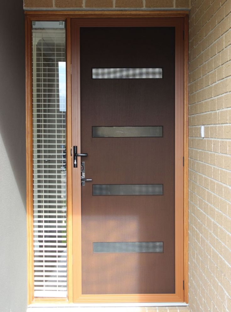 timber look frame stainless steel security door by sunrise painting services