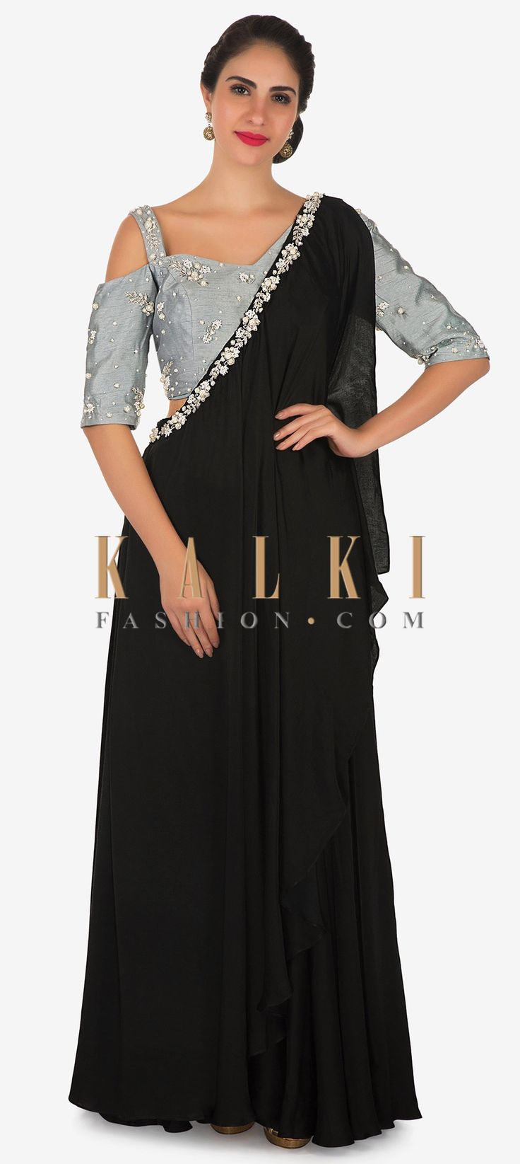 Buy Online from the link below. We ship worldwide Click Anywhere to Tag Debina Bonnerjee in Kalki black skirt with grey blouse matched with fancy dupatta only on Kalki  Black skirt featuring in satin. Matched with grey raw silk blouse embellished in moti and zardosi embroidery. It comes with fancy drape dupatta in black with embroidered border. Celebrity-Debina Bonnerjee, Actress. Slight variation in color is possible.