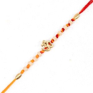For your dear brother in India who is shy to wear big and colorful Rakhi, Giftblooms.com brings you this simple yet beautiful Rakhi which you can send him. This Rakhi has a Om symbol at the centre with white and golden beads on both its sides. Furthermore, the orange and red threads, with the help of which the Rakhi is tied, gives it a very authentic look. Thus, gift your brother this beautiful Rakhi and give him a lovely surprise.