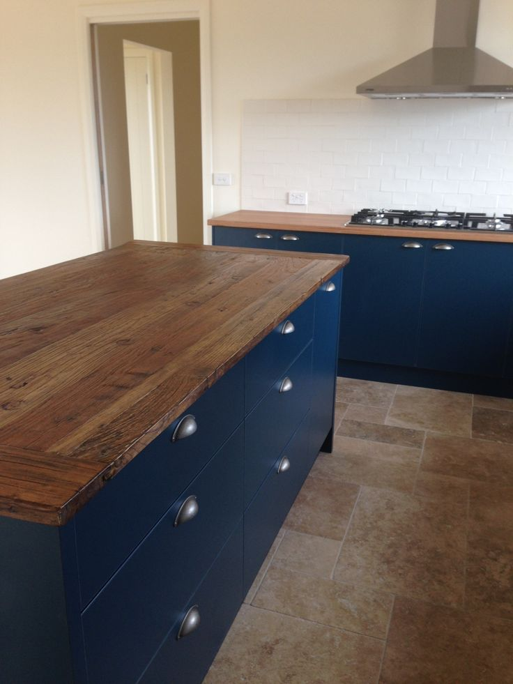 Kitchen.  Cabinets in Deep Sea.  Island bench top: recycled Elm.  Benchtops in Blackbutt