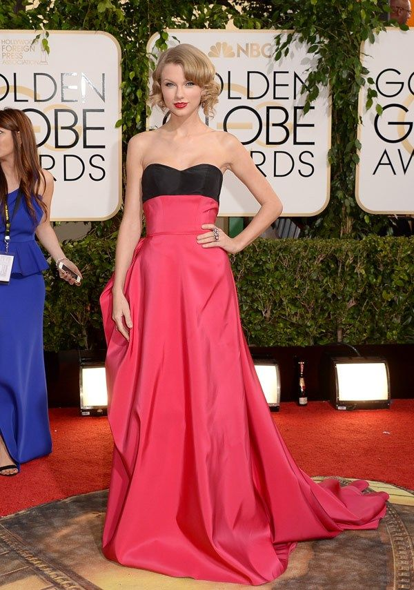 #TaylorSwift in a #CarolinaHerrera wild rose silk faille strapless gown with back bustle at the 2014 #GoldenGlobes.