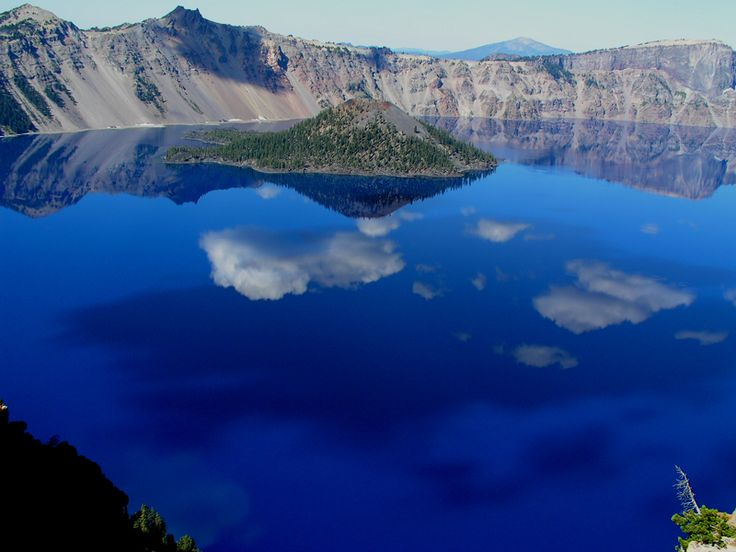 Crater Lake in the Cascade Mountains of Oregon. Revered as sacred waters by the Klamath Indians. Believed to be formed by a catastrophic battle between the chief of underworld and the chief of the world above (a powerful volcanic eruption). Many venture there to see visions.