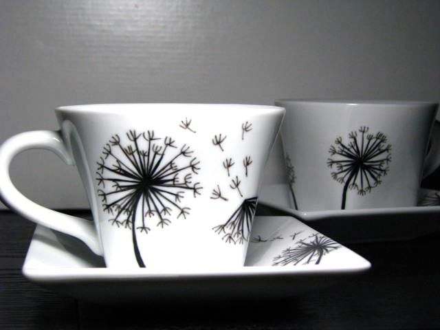 Hand Painted Cup and Saucer Set (2)- Dandelions. $34.00, via Etsy.