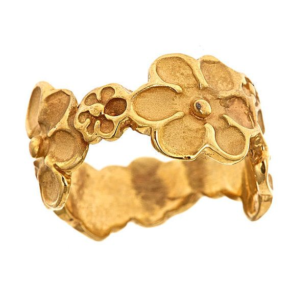 Gorgeous 14k gold plated ring featuring a design with flowers wrapped around the entire band. This ring can be rose or yellow gold in color.