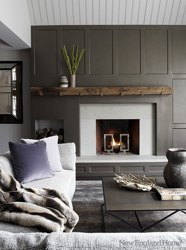 Slate grey wainscot, reclaimed wood mantle, offset log storage. I LOVE THIS…