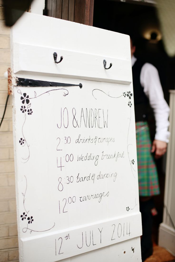 Order of Service on a rustic door - Image by Dasha Caffrey - Rustic Wedding With Tartan Accents And Bride In Elegant Gown From Go Bridal With A Sassi Holford Veil And Rachel Simpson Shoes With Groom And Groomsmen In Kilts
