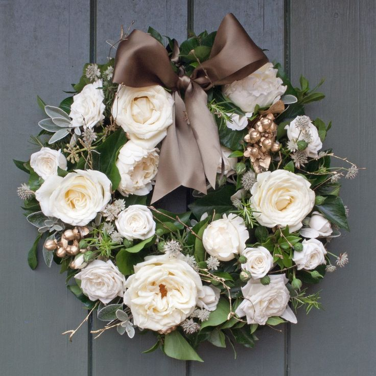 This beautiful Gold & Ivory door wreath has a mixture of luxury scented ivory Vitality roses and Cream Piaget roses which are exclusively grown on our farm in Kenya. We have mixed these beautiful roses with gold Hypericum berries in this deluxe arrangement with seasonal winter foliage, all grown on our English Farm. AVAILABLE TO PRE ORDER FOR CHRISTMAS. FIRST DELIVERY DATE FOR THIS WREATH IS TUESDAY 2ND DECEMBER 2014!