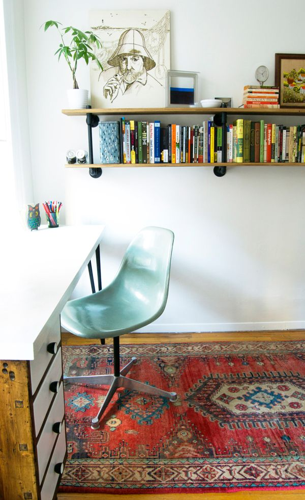DIY bookshelves and desk, awesome chair, oriental rug.  I want this room.