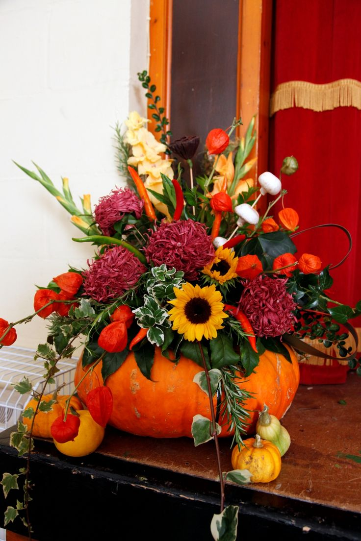 Halloween Theme - This autumn theme bouquet in a pumpkin is a lovely table centerpiece.
