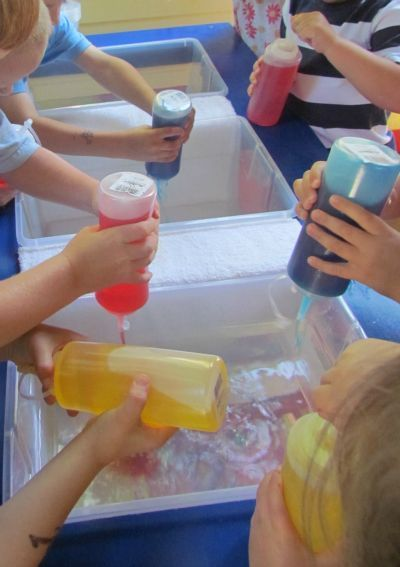 We should just do this in the water table or pool outsede Squeezable colored water play by Teach Preschool