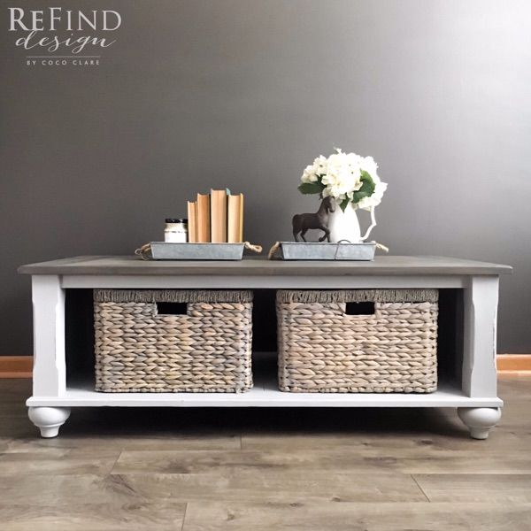 Custom redesigned Coffee Table. Custom weathered brown stain using General Finishes Water Based Stains.  Hand painted base and farmhouse baskets.