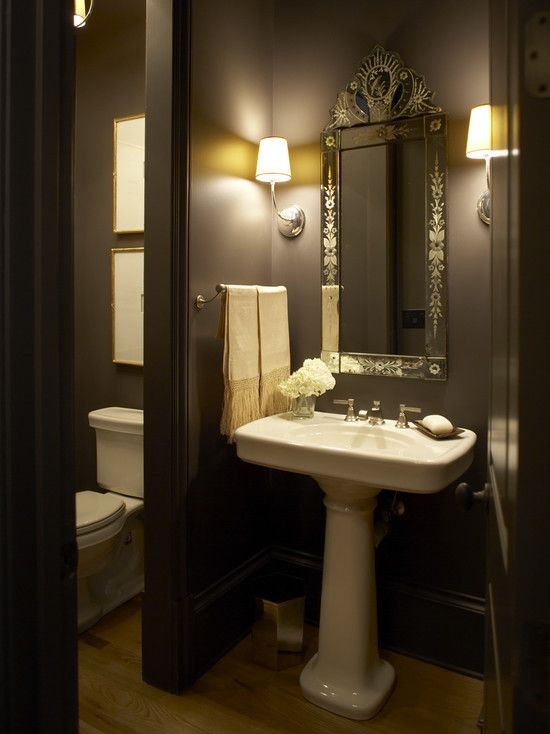 Traditional home stunning powder room with bold black for Powder room color ideas