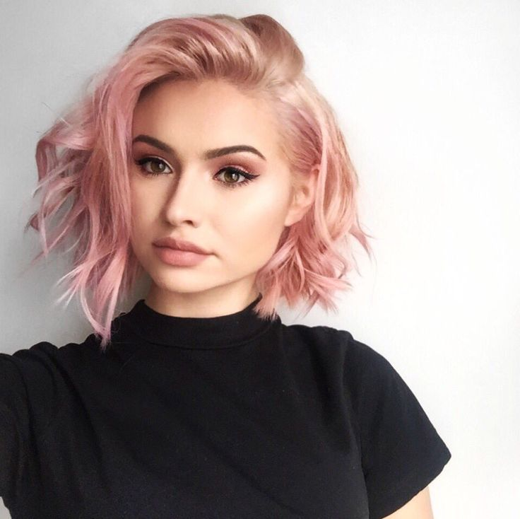 LOVE her haircut  want to cut this way, but also want to see it straight. WHO IS THIS