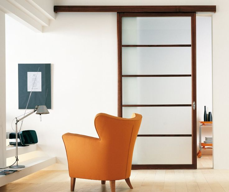 Exit Sliding Door Featuring Acid Etched Laminated Glass With Canaletto Walnut Framed Panel