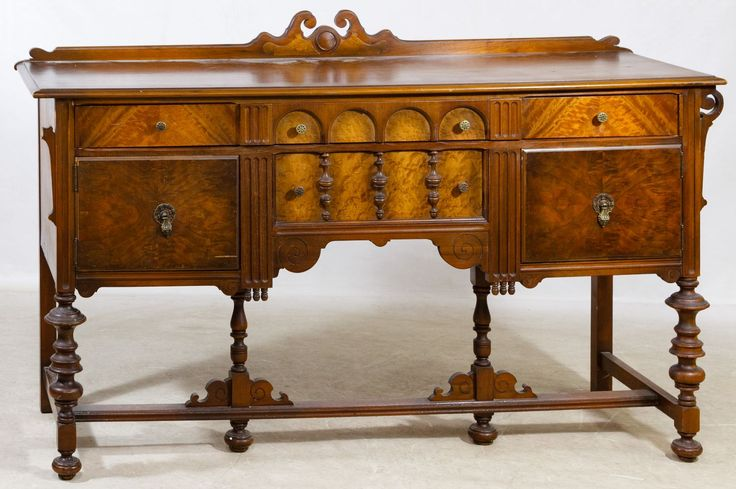 Lot 60: Burled Mahogany Sideboard; Having a full upper drawer over a smaller center drawer flanked by wood panel doors