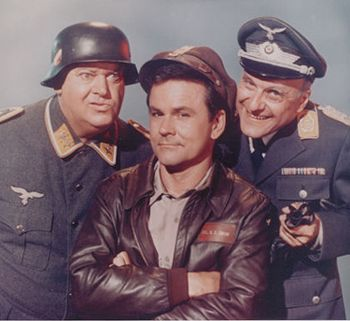 Hogan's Heroes..1965-1971..so funny at the time. P.O.W camp, Stalag 13, a group of prisoners running undercover ops to sabotage the enemy, running rings around Colonel Klink, and a rather thick guard called Schults! Very much a Carry On format