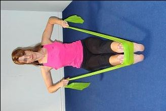 Rowing (Posture Exercises using Pilates) Exercise to IMPROVE POSTURE.//The pulling action helps to strengthen the upper back & shoulders & to open & stretch the tight muscles of the chest that round us forward. The rowing exercise shown here with the band is easy to do anywhere. Just wrap the band around your feet and tension the band as much as you wish and then start pulling.//Move your elbows wide or narrow for different engagement of muscles in the back.